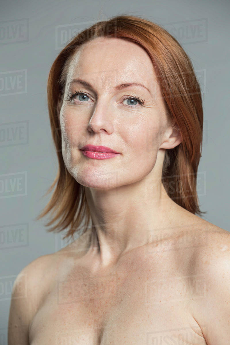A professional image of a red headed mature lady