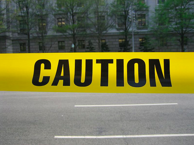 A picture of yellow tape with the word caution written across it